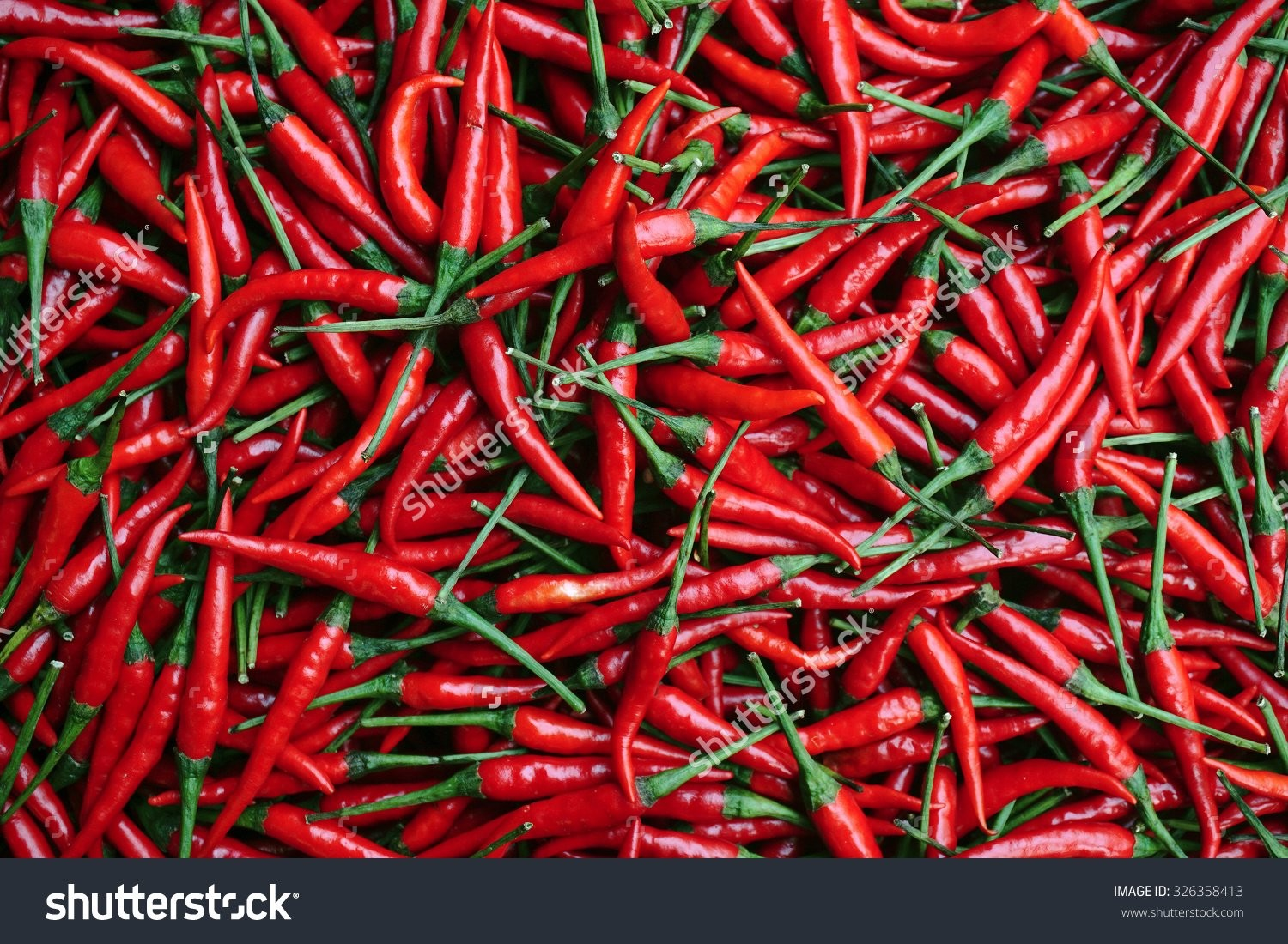 stock-photo-red-chillies-background-selective-focus-326358413